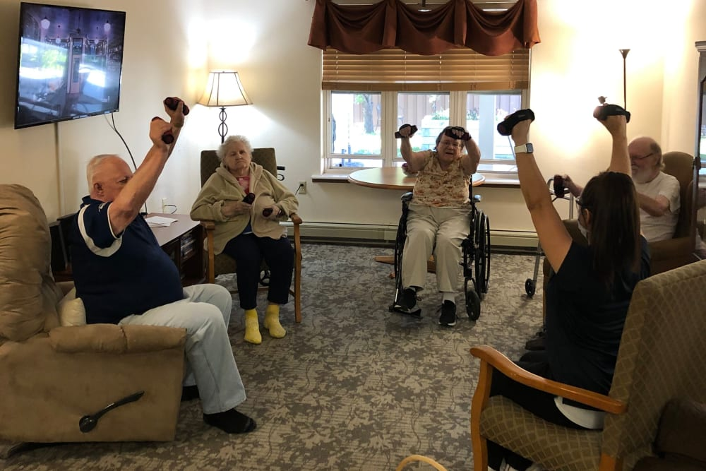 Residents participate in strength training exercises at Landings of Sauk Rapids in Sauk Rapids, Minnesota