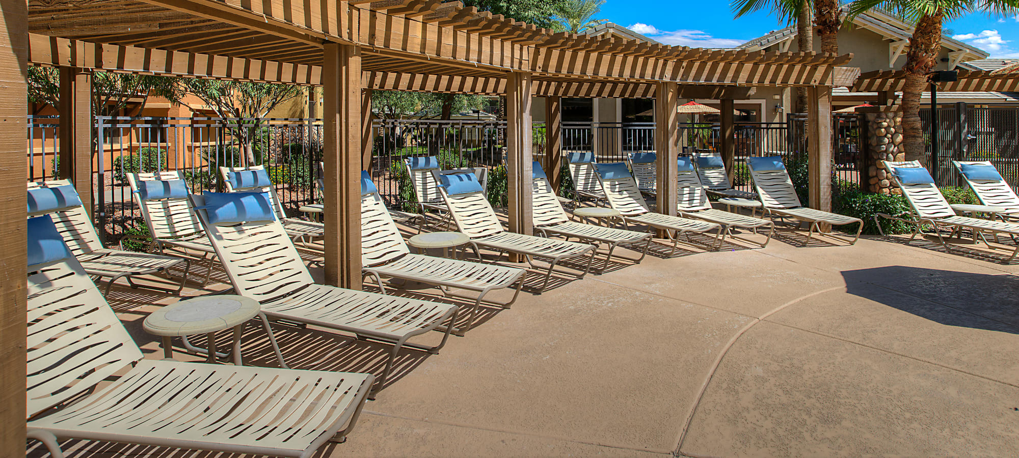 Plenty of seating next to the swimming pool at Azul at Spectrum in Gilbert, Arizona