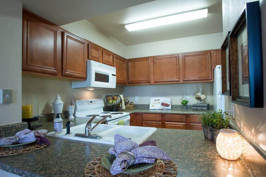 Kitchen with white appliances at Villas at Stonebridge in Edmond, Oklahoma