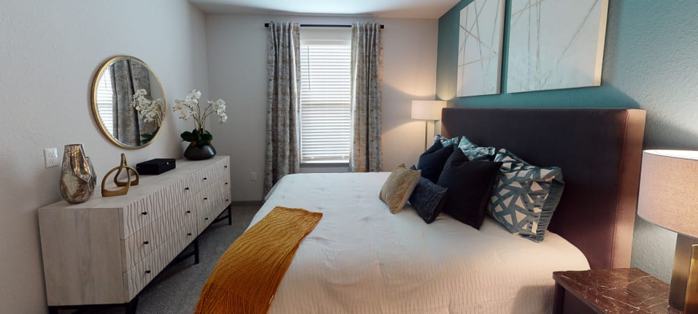 Nice well lit bedroom in a decorate model home at Integra 289 Exchange in DeBary, Florida