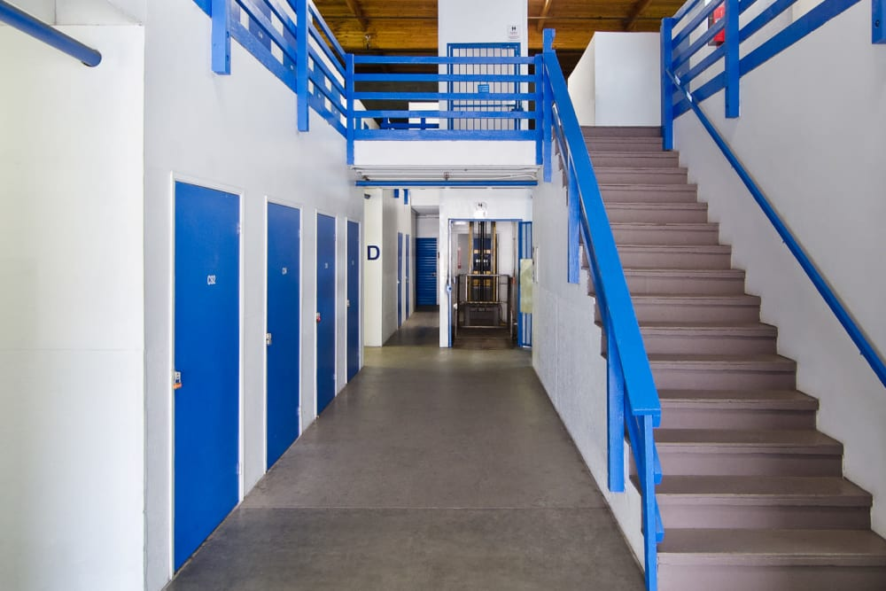Ground-floor storage lockers and staircase at A-American Self Storage in Santa Barbara, California