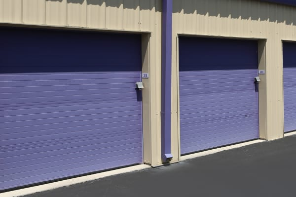 Storage units with purple doors at Midgard Self Storage in Lexington, South Carolina