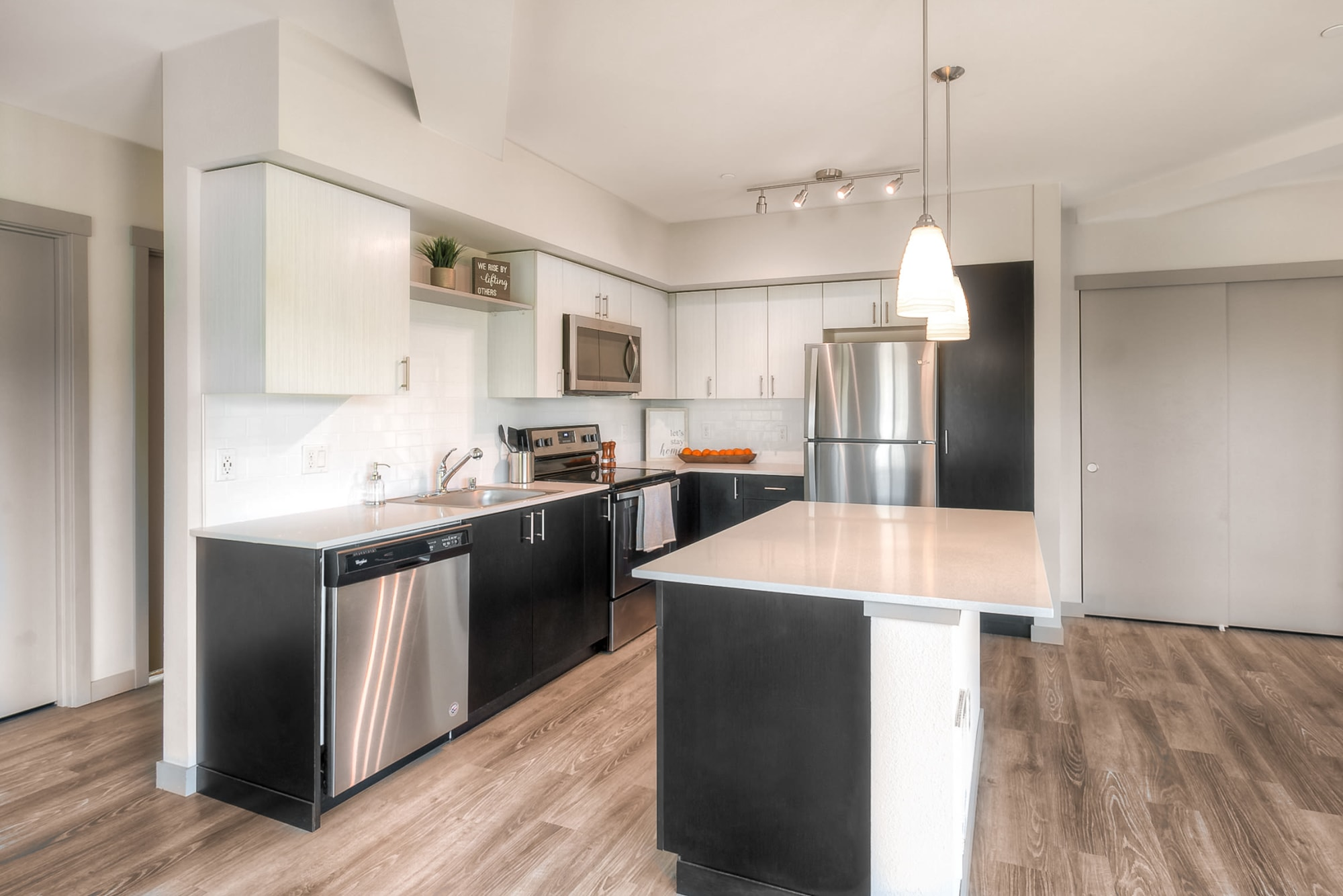 A kitchen with stainless appliances at Tria Apartments in Newcastle, Washington