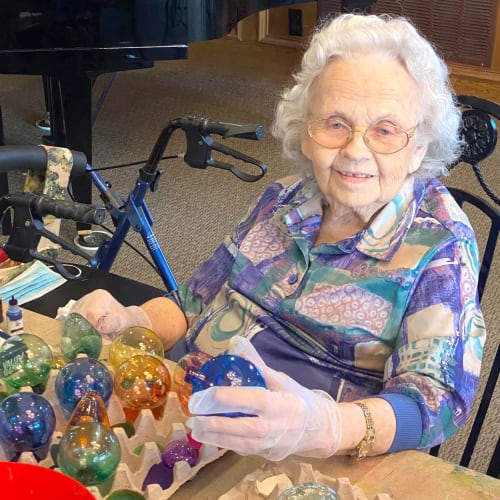 Resident decorating baubles at Canoe Brook Assisted Living in Ardmore, Oklahoma