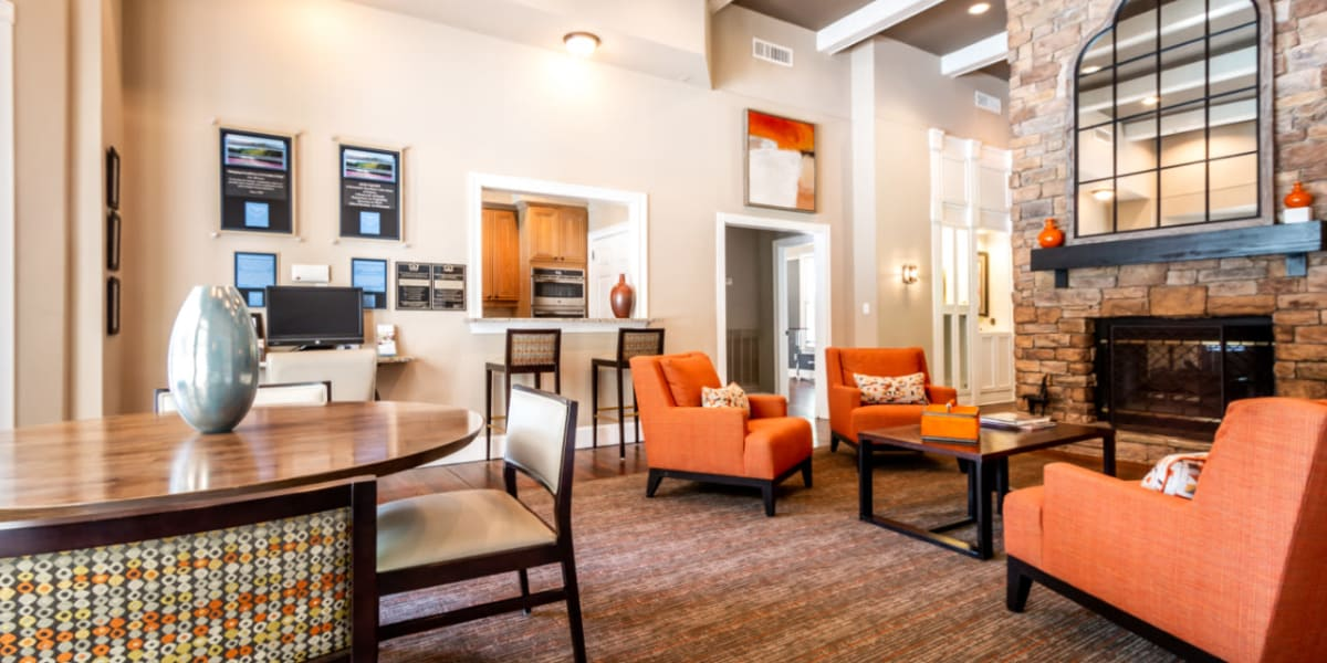 Community clubhouse sitting area with kitchen area at Marquis at Sugarloaf in Duluth, Georgia