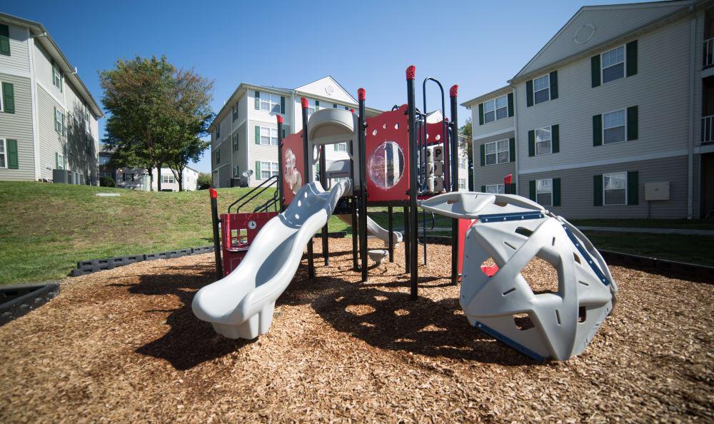 Play at the big playground at England Run North Apartments