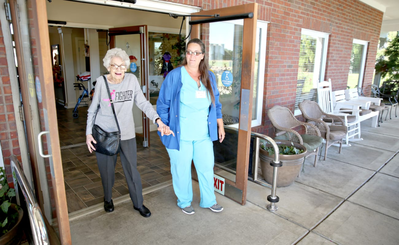 Resident and staff member going for a walk near Providence Assisted Living in Senatobia, Mississippi.