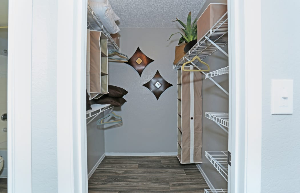 Walk-in closet in a model home at Solis at Flamingo in Las Vegas, Nevada