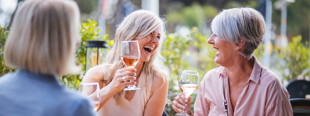 Friends gather for wine at Hawthorn Village Apartments in Napa, California