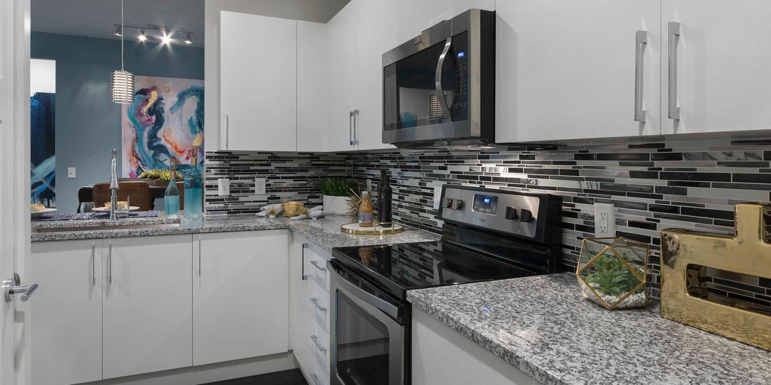 Show off our chef skills with Ancora Apartments' beautiful custom kitchens.