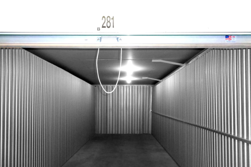 View inside a storage unit with a roll up door at Capital Self Storage in Harrisburg, PA