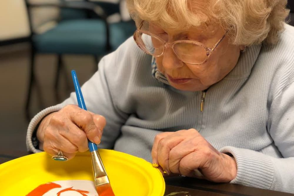 A resident painting a plate at The Meadows of Kalida in Kalida, Ohio