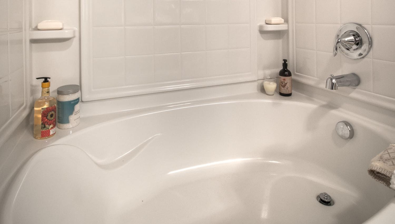 Oval soaking tub in a model home's master bathroom at Olympus Encantada in Albuquerque, New Mexico
