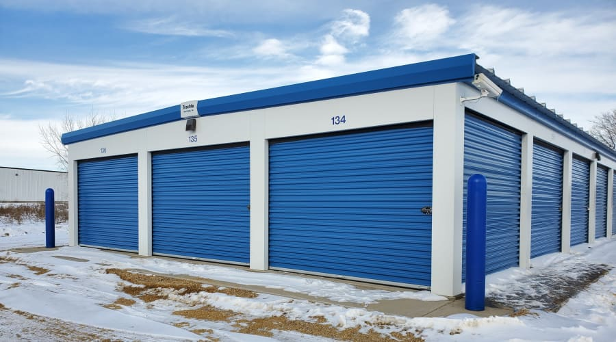 Storage units with blue doors at KO Storage of Waseca 15th Ave in Waseca, Minnesota