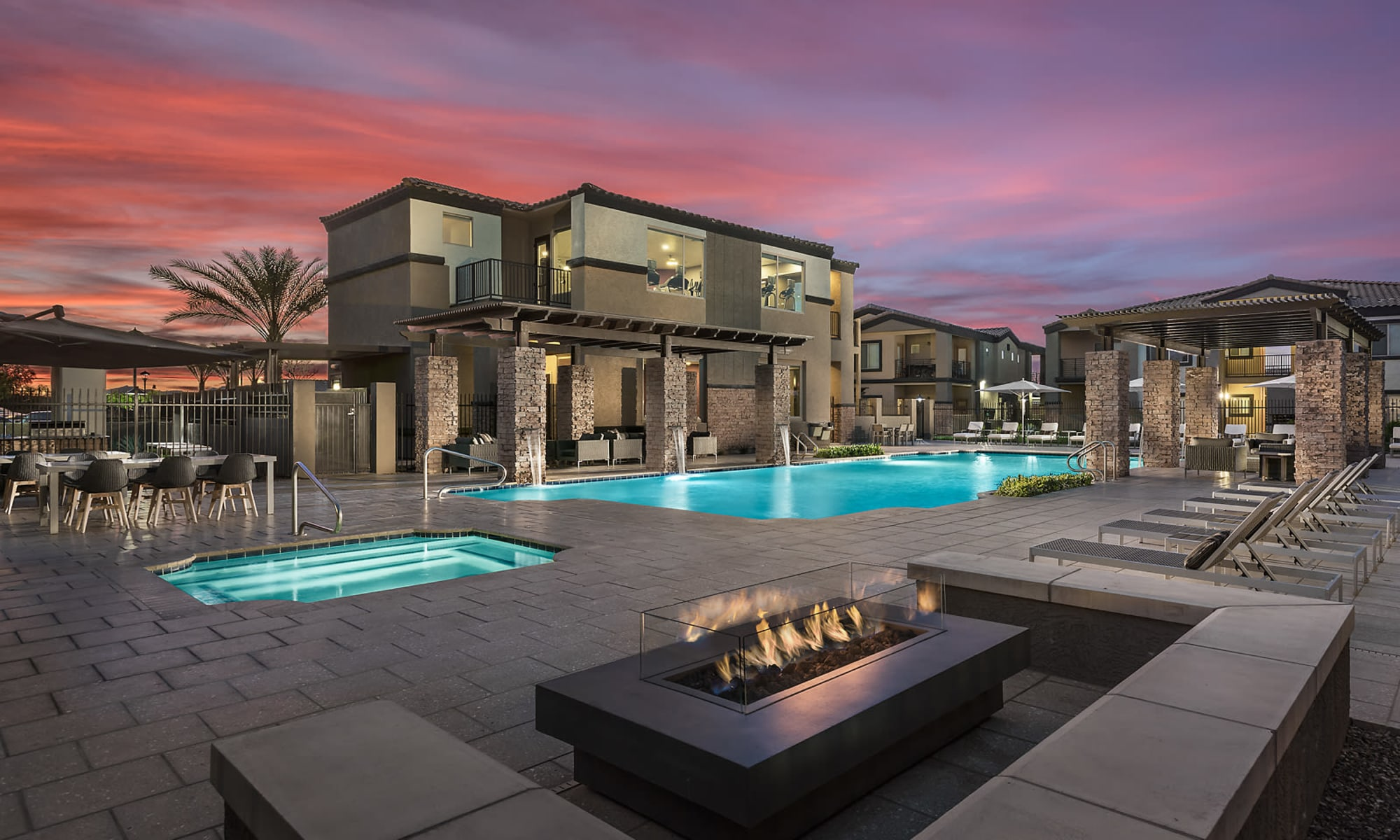 Swimming pool  and lounge area at The Maxx 159 in Goodyear, Arizona