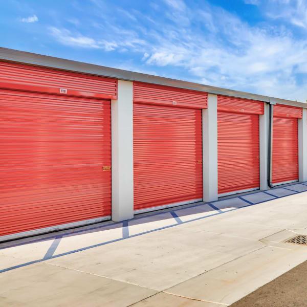 Outdoor storage units with red doors at StorQuest Self Storage in Bermuda Dunes, California
