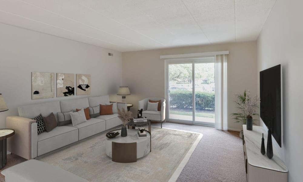 Carpeted living room at Vantage Pointe West Apartments in Cincinnati, Ohio
