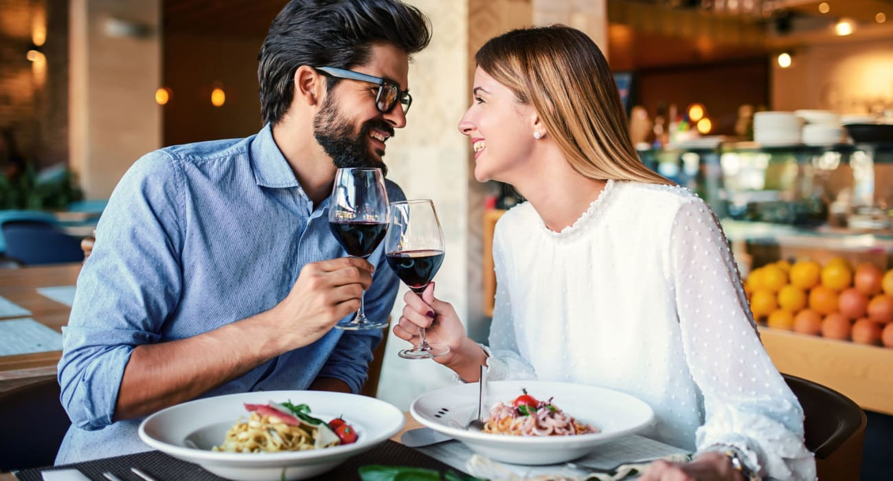 Couple enjoying dinner and wine together near 140 Prospect in Hackensack, New Jersey