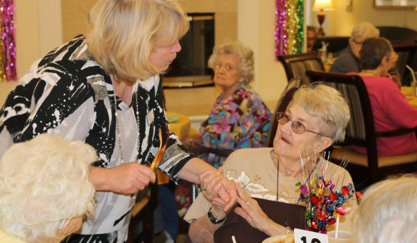 Staff member caring for our residents at Azalea Estates of Shreveport in Shreveport, Louisiana.