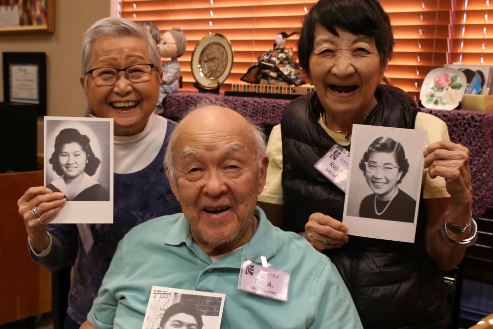 Residents holding up old photos of themselves at Nikkei Manor in Seattle, Washington