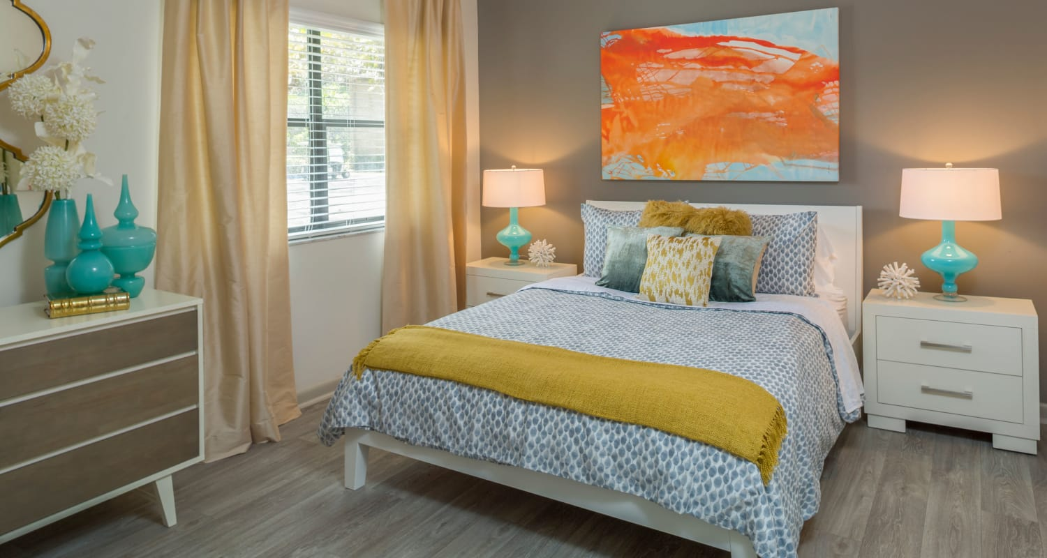 Large bedroom with wood-style floors at Siena Apartments in Plantation, Florida