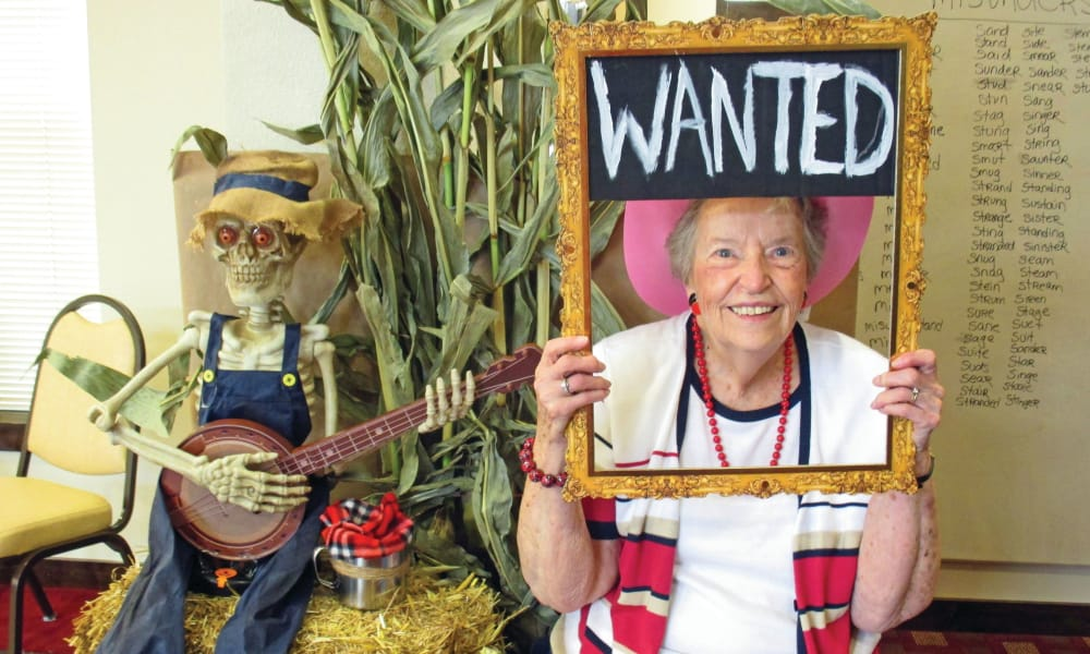 A resident posing with a wanted sign at Carolina Estates in Greensboro, North Carolina