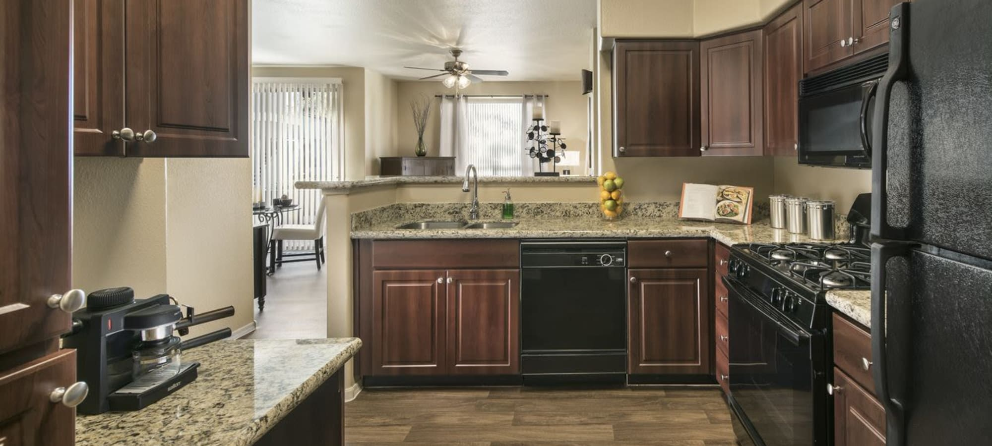 Beautiful brown kitchen at Laguna at Arrowhead Ranch in Glendale, Arizona