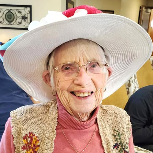 A smiling resident at The Oxford Grand Assisted Living & Memory Care in Kansas City, Missouri