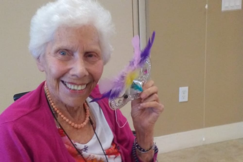 Resident making arts and crafts at Merrill Gardens at Huntington Beach