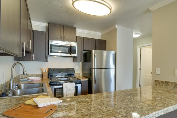 Brown renovated kitchen model at Carriage House Apartments in Vancouver, WA