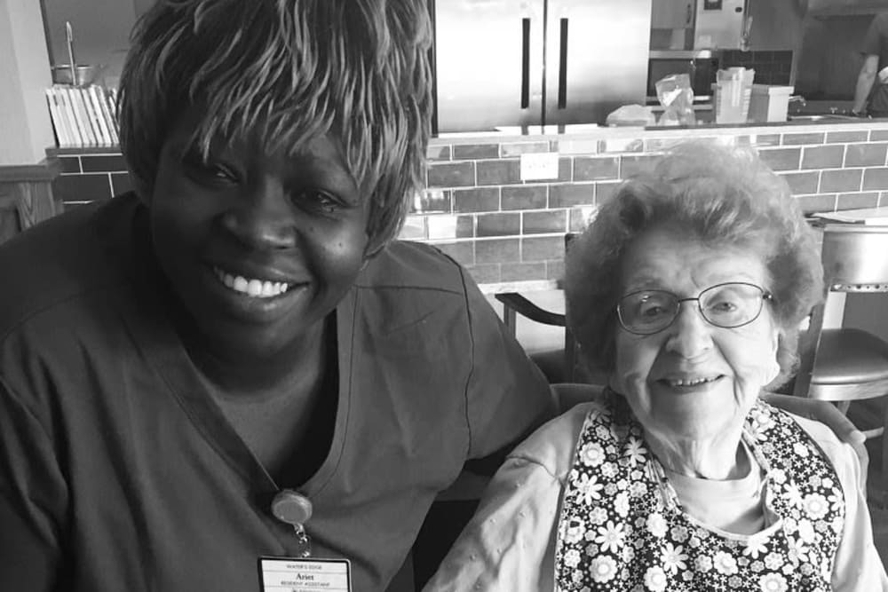 A resident and a staff member smiling at Water's Edge in Mankato, Minnesota