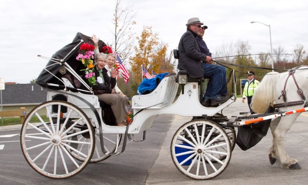 Residents in a horse-drawn carriage near Camden Springs Gracious Retirement Living in Elk Grove, California
