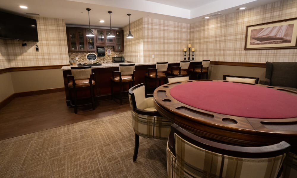 Game room with bar lounge and card table at The Sanctuary at St. Cloud in St. Cloud, Minnesota