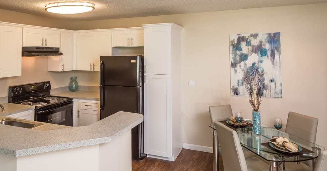 kitchen and dining area in Huntington Place apartment