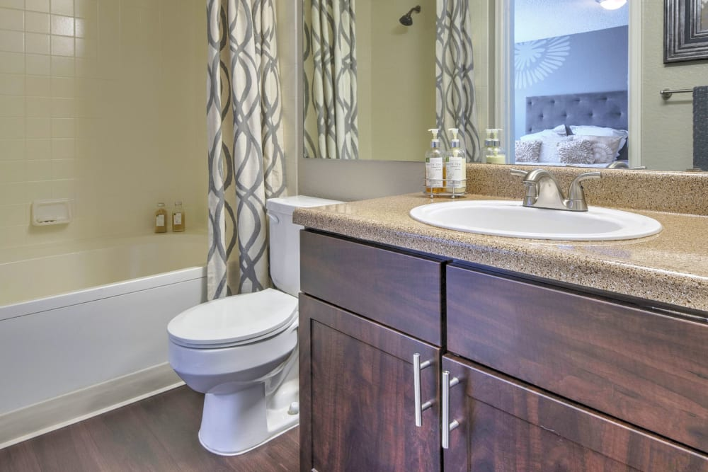 Stylish, updated cabinetry in bathrooms at Arapahoe Club Apartments in Denver, Colorado