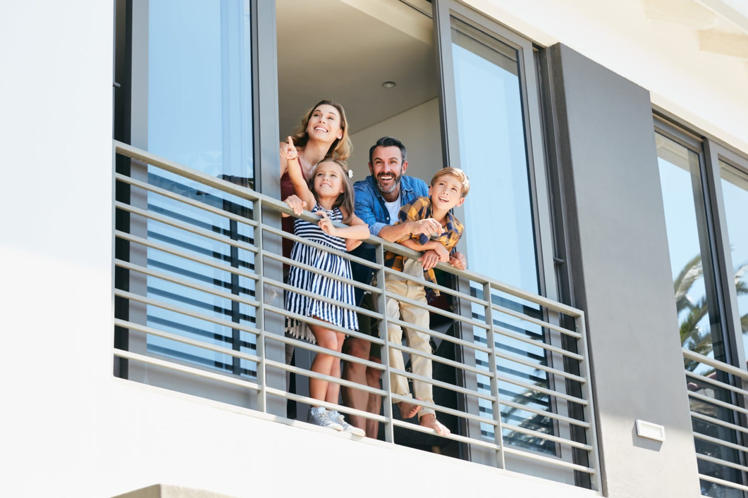 Family on their balcony at The Severn Companies in Annapolis, Maryland