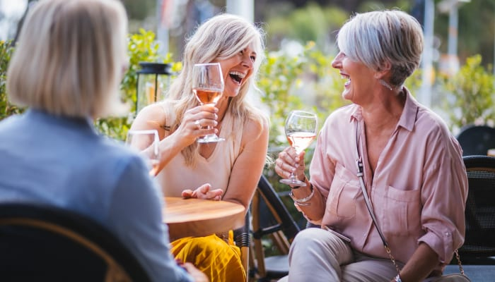 Residents dining together outside of The Springs at Lake Oswego in Lake Oswego, Oregon