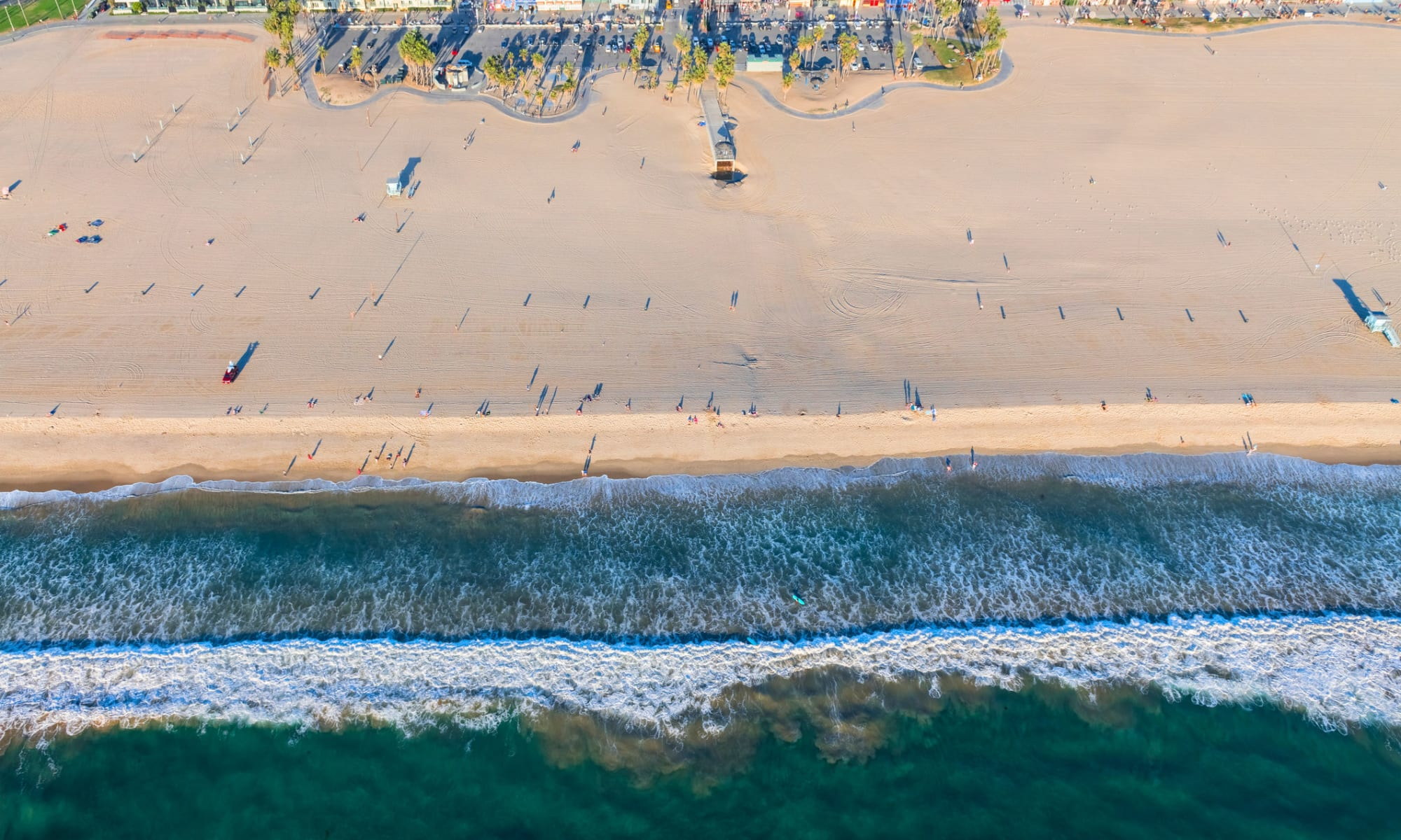 Aerial view of the beach and shoreline near The Meadows in Culver City, California