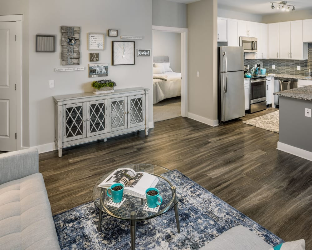 Spacious living room with woo style flooring at The Beacon at Gateway in Scarborough, Maine