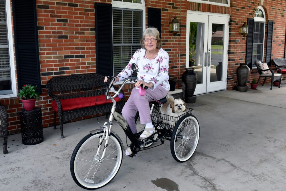 Riding a bike with a dog at Garden Living Millstadt in Millstadt, Illinois