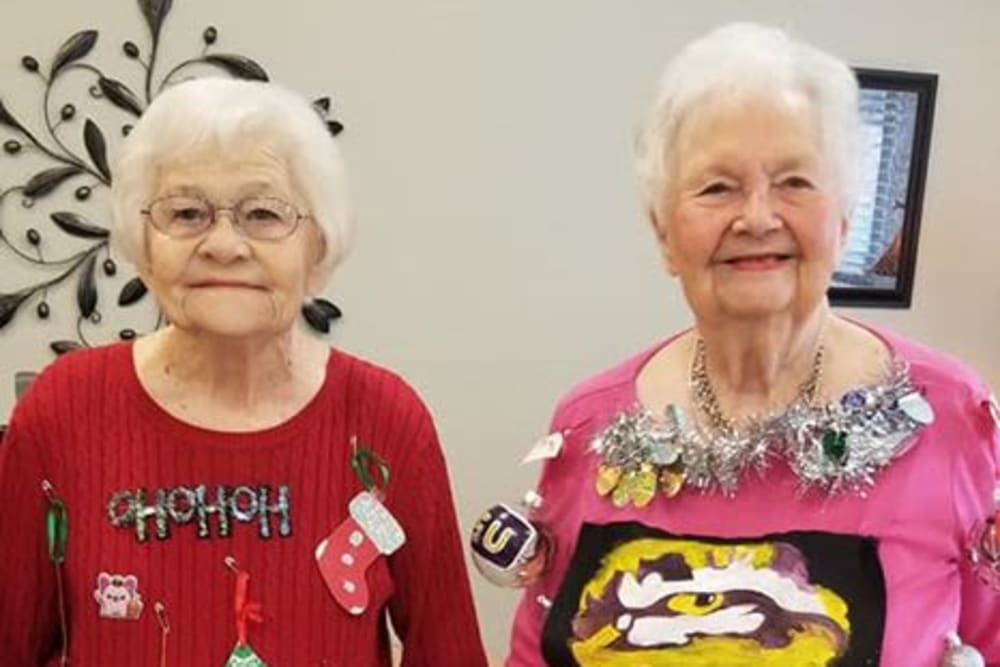 Two happy seniors at Rosewood Assisted Living in Lafayette, Louisiana