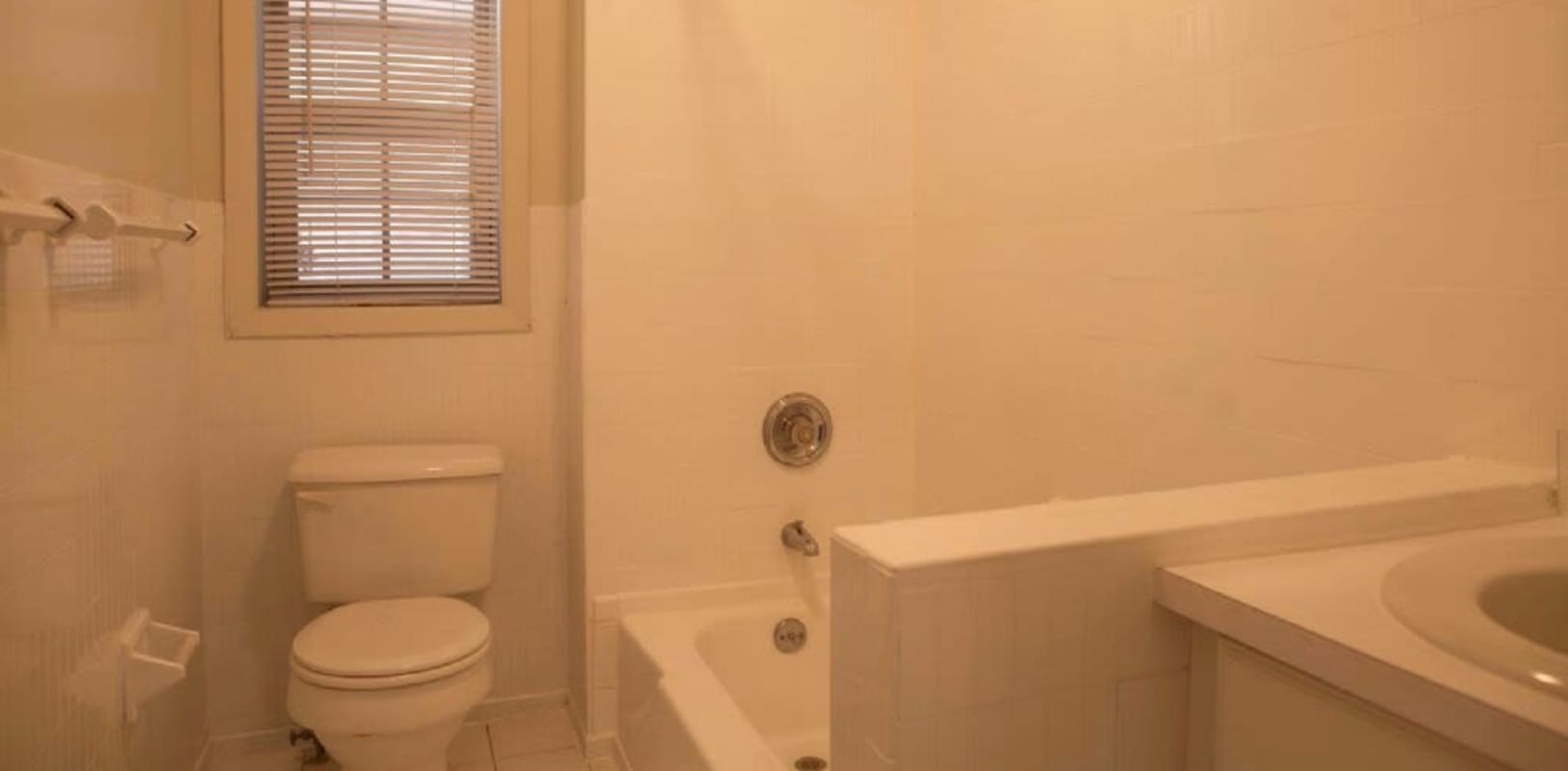 Bathroom with window to outside at Versailles Apartments in Ewing, New Jersey
