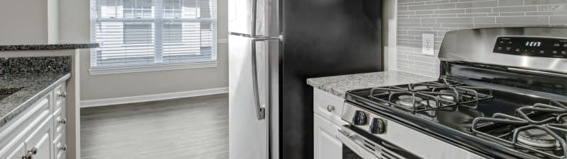 Bright kitchen with stainless steel appliances at Bradlee Danvers in Danvers, Massachusetts