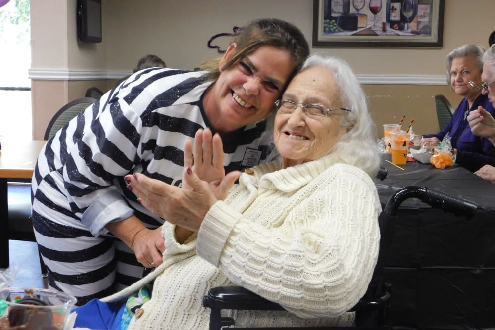 A resident and a staff member on Halloween at Bradenton Oaks in Bradenton, Florida