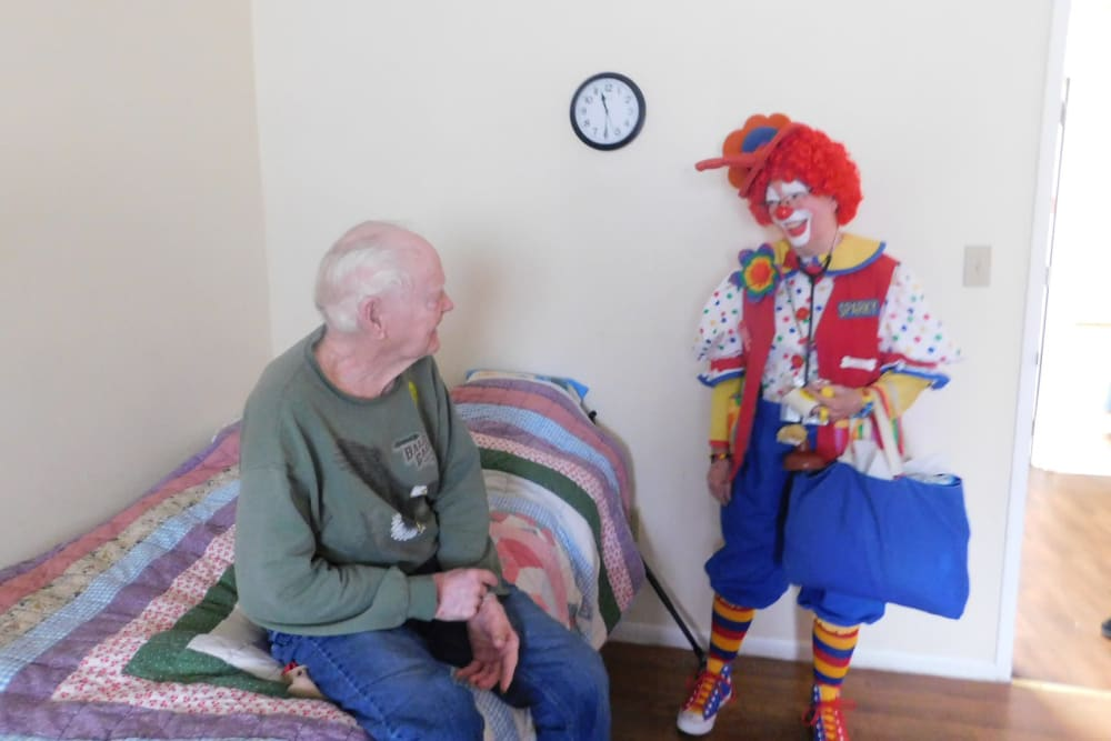 A resident being visiting by a clown at Bradenton Oaks in Bradenton, Florida