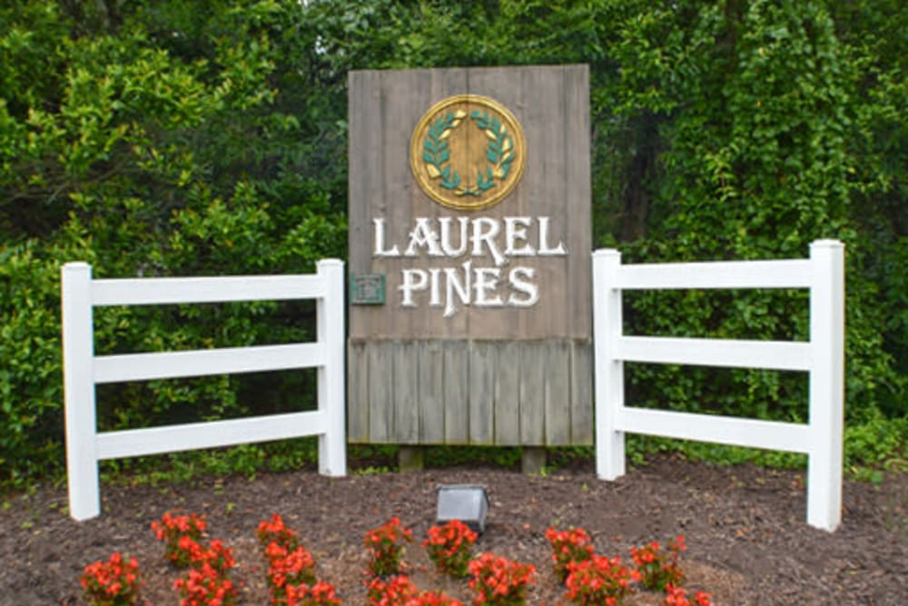 Entry way signage and garden of Laurel Pines Apartments in Richmond, Virginia