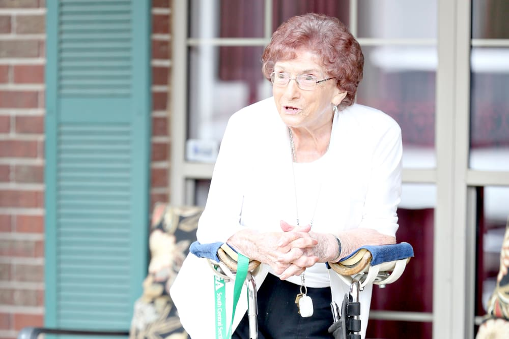 A resident enjoying being outside at Providence Assisted Living in Springdale, Arkansas.