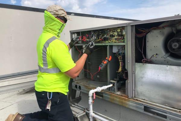 A worker looking at wires at Patriots Glen in Bellevue, Washington.