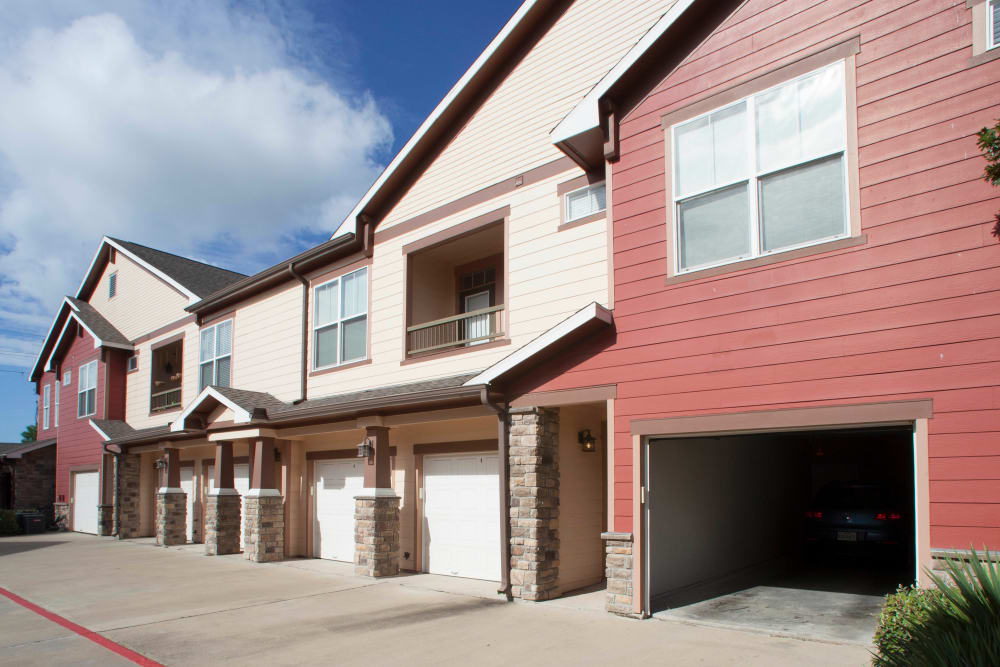 Private garages attached to resident building at Olympus Katy Ranch in Katy, Texas