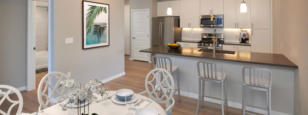 Open design kitchen and dining area at Hawthorne Hill Apartments in Thornton, Colorado